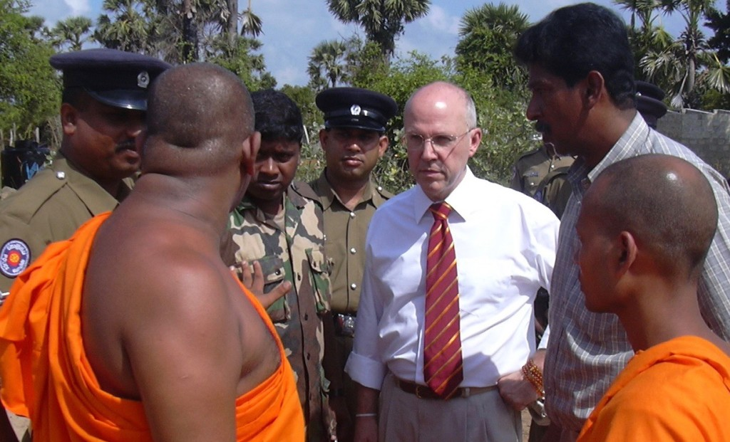 Reoch with senior Buddhist monks and police in North East Sri Lanka near the war zones in the country's 30-year war.