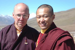 Sakyong Mipham Rinpoche with President Reoch in Tibet. The fabled Mount Magyal Pomra is in the distance directly behind them.